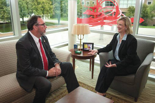 Submitted photos At left, Steven L. Johnson, chairman and CEO of Sinclair College visits with Cheryl B. Schrader, Wright State University's seventh president in her office in University Hall.