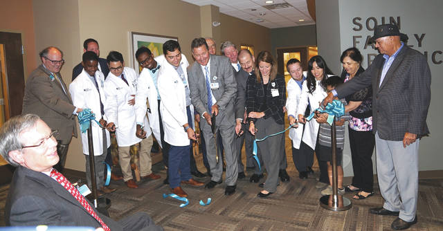 Barb Slone | News-Current Dr. James Tyko helps cut the ribbon on the new medical residency program the Soin Family Practice Center.