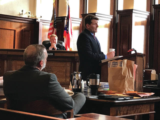 Anna Bolton | News-Current Detective Brian Neiford and Judge Michael Buckwalter look on as assistant prosecutor David Hayes (right) makes his opening statements to the jury Aug. 29.
