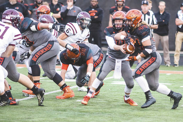Don Tate | News-Current Beavercreek quarterback Cody Hocker (11) fakes a handoff to fullback Kaden Wenger, during first-half action in Thursday's Sept. 13 double-overtime thriller on Frank Zink Field at Beavercreek High.