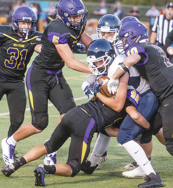 Don Tate | News-Current A flock of Golden Eagles tackle a Valley View ball carrier in Bellbrook's home loss, Sept. 29.