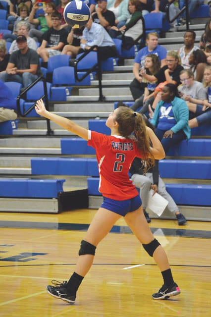 Carroll's Logan DeLisle (2) unleashes a serve during the Patriots' 25-12, 25-21, 25-14 win over host Xenia, Oct. 4 at Xenia High School.