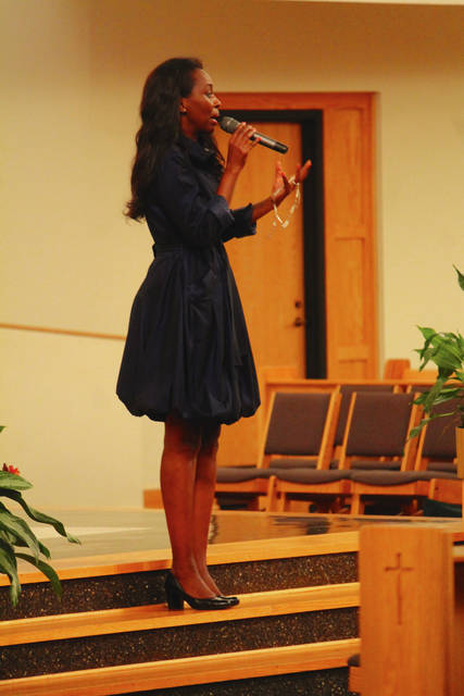 Anna Bolton | News-Current Rosary in hand, Immaculée Ilibagiza shares her story with retreat-goers at St. Luke Catholic Church in Beavercreek Oct. 13-14.
