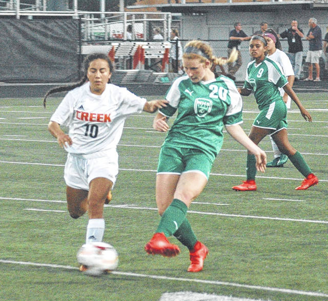 Ron Nunnari | Aim Media Midwest Northmont's Jillian Naas makes a pass past Beavercreek defender Diana Benigno, who later scored the only goal in Wednesday's Sept. 20 girls high school soccer match in Beavercreek.