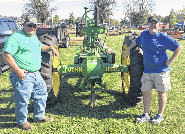 Submitted photo Lester Davis and Jay Russell with a tractor that will be part of the fall festival hosted by Old Timers and North Side Christian Church.