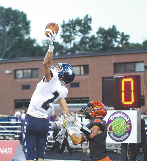 Fairmont junior wide receiver Ryan Hall makes a one-handed catch against Beavercreek's Drew Nanda, in Friday's 14-3 loss to host Beavercreek. Hall led all receivers with three grabs for 67 yards.