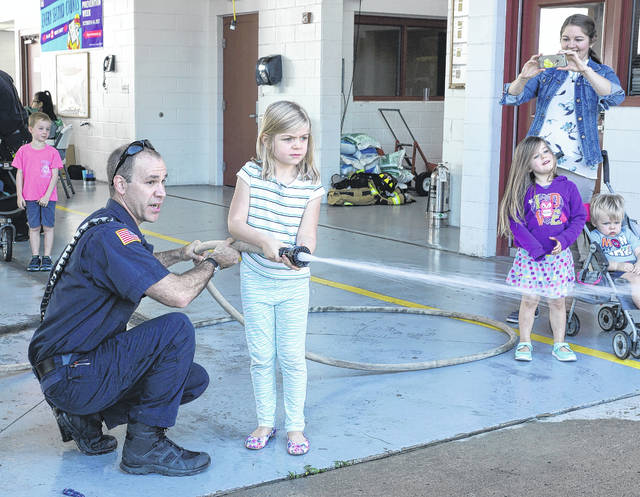 Barb Slone | News-Current Beavercreek Fire Station No. 61, 2195 Dayton-Xenia Road hosted an open house celebrating Fire Prevention Week on Oct. 14. Youth got to learn fire safety tips, learn how to use fire equipment and even try out working the fire hose.