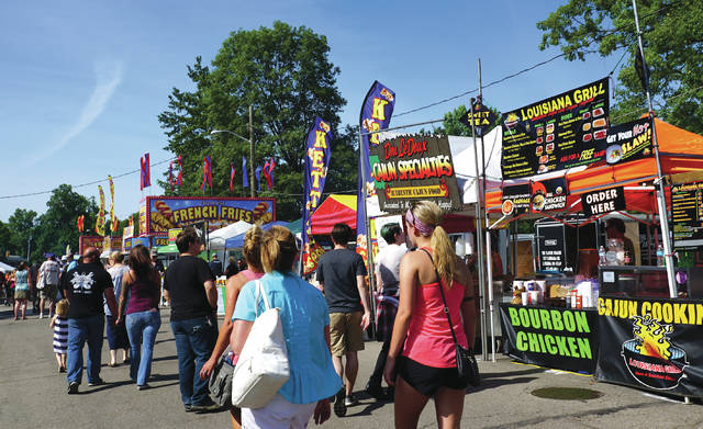 File photos The Yellow Springs Street Fair will feature more than 200 vendors.