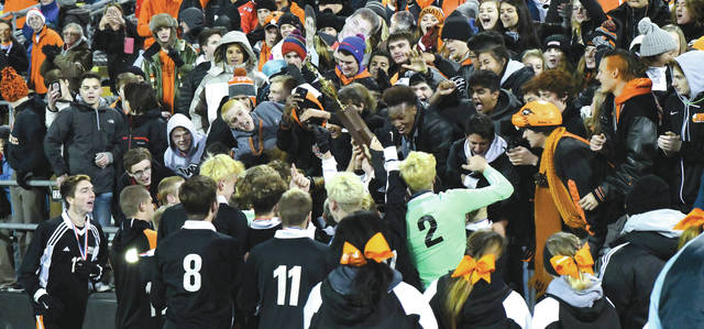 Beavercreek fans react as the team brings the Division I boys state soccer championship trophy over to the sidelines, Nov. 11 at MAPFRE Stadium in Columbus.