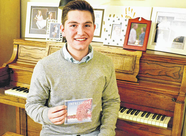 Danielle Coots | News-Current Beavercreek resident Nathan Bain debuts his first album entitled <em>Impressions</em>, that features nine original piano solos that he composed and recorded.
