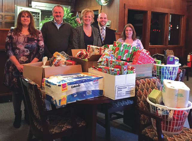Submitted photo Deputy Treasurer Christy Combs, Greene County Treasurer Dick Gould, Chief Deputy Treasurer Sandy Brubaker, Chief Deputy Recorder Andrew Williams and Deputy Treasurer Yvette Lynch collected clothes, toys and a turkey dinner for a Xenia family.