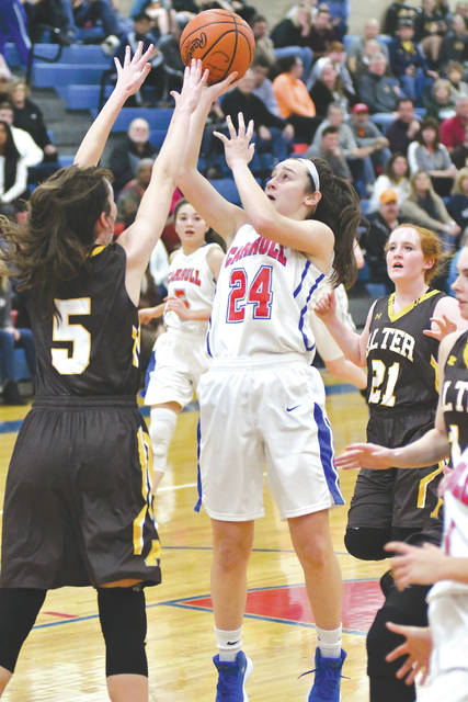 Carroll sophomore guard Allie Stefanek (24) shoots over Alter's Kala Gillis (5) in the first half of Wednesday's game at Carroll High School. The host Patriots won the GCL Co-Ed contest, 43-26, snapping a nine-game losing streak to Alter.