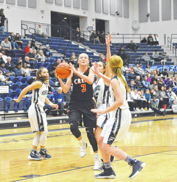 Bailey Draughn, of Beavercreek, puts up a shot while surrounded by a trio of Fairmont Firebirds, Wednesday, Jan. 3 at Trent Arena in Kettering.