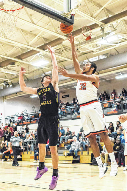 Don Tate | News-Current Beavercreek's Jayme Johnson scores two of his six points as Bellbrook's Jack Campbell defends.