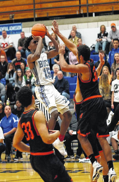 Barb Slone | News-Current Xenia's Samari Curtis (15) goes up for a shot as Beavercreek's Jayme Johnson goes for a block. Curtis scored a game-high 34 points in the Xenia win.