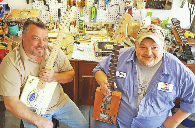Jim Davis | Aim Media Midwest John Creekmore, left, and Larry Morgan – friends for more than 35 years – are taking their passion for music to a new level with Morgan Garage Guitars.