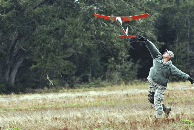 Submitted photo Senior Airman Andrew Goffeney, 1st Special Operations Security Forces Squadron combat arms journeyman, launches a RQ-11B Raven at Choctaw Field, Fla., March 4, 2014. Goffeney practiced launching the small unmanned aerial system, which requires a specific technique for takeoff.