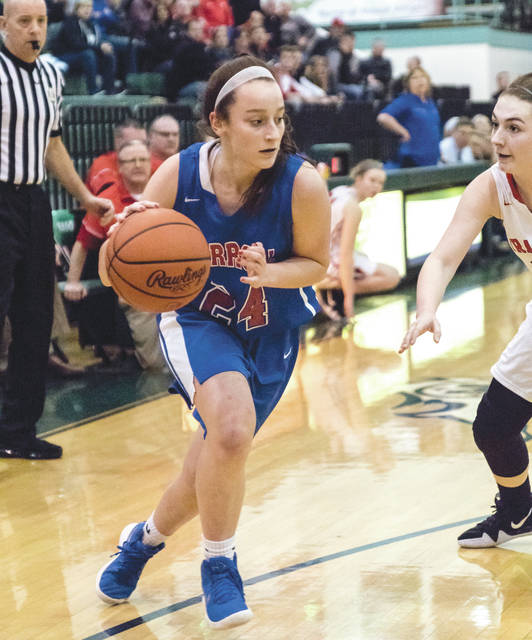 Allie Stefanek drives around a Franklin defender during Saturday night's Division II district championship game in Mason.