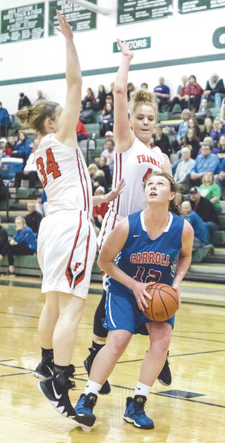 File photos Carroll's Julia Keller (12) was named to the Division II All-Ohio Honorable Mention team by the Ohio Prep Sports Writers Association this season.