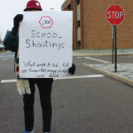 Walkout prompts woman's peaceful protest