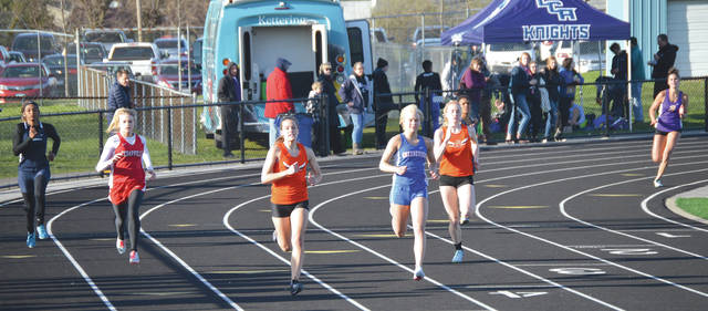 Beavercreek freshman Ashtyn Gluck (lane four) set a meet record in the girls 400-meter dash, Thursday April 19 in the Greene County High School track and field championship meet, at Doug Adams Stadium in Xenia.