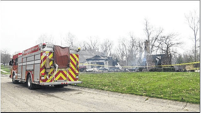 WDTN photo Beavercreek Fire Department crews put out a house fire April 14.