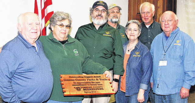 Submitted photo Honored for their commitment to honey bees, Greene County Parks & Trails (GCP&T) received the Greene County Beekeepers Association Outstanding Support Award at their March meeting. Current and past presidents Bill Starrett, GCP&T Chief Naturalist Cris Barnett, Mark Weaver, Dan O'Callaghan, Terry-Lieberman-Smith, Gene Glover and Dave Foubert presented the plaque. GCP&T has worked with the association for years in providing support and hosting educational events to the general public. For more information about GCP&T or honeybee programs, call 937-562-6440, email info@gcparkstrails.com or visit www.gcparkstrails.com.