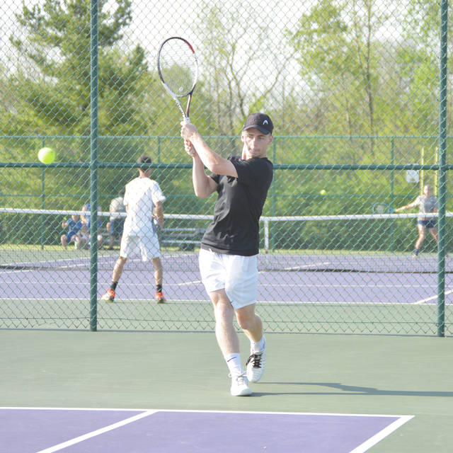 Beavercreek senior Alex Riess follows his backhand shot May 11 in a Division I boys sectional tennis tournament match in Centerville against Vincent Lyons of Springboro.