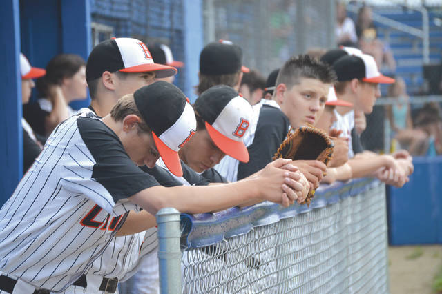 Beavercreek players wait from the home dugout during Thursday's May 17 rain delay at Xenia High School.