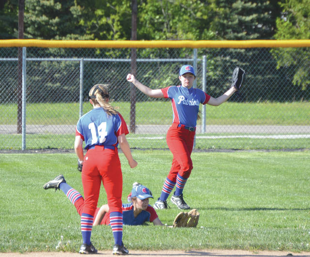 Patriots center fielder Camryn Joseph checks her glove to make sure the ball is still in the webbing, after making a diving catch for a first inning out, May 10, at Bellbrook High School.