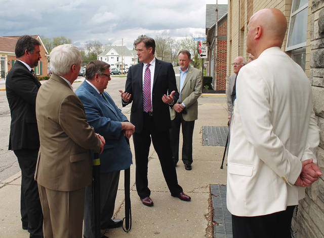 Anna Bolton | Greene County News Congressman Mike Turner (center) speaks with County Administrator Brandon Huddleson, Greene County Commissioners Alan Anderson, Bob Glaser and Tom Koogler (not pictured), Treasurer Dick Gould, Sheriff Gene Fischer (not pictured) and Jail Administrator Maj. Kirk Keller May 3 outside the Greene County Jail.