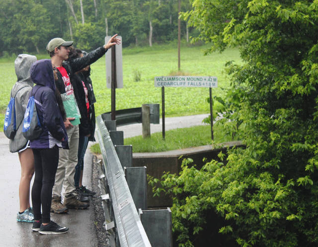 BHS students Jeemi Shah, Anya Greize, Parker Clark, Elizabeth Sakulich and Bianca Neale look out over Massie Creek during aquatics testing.