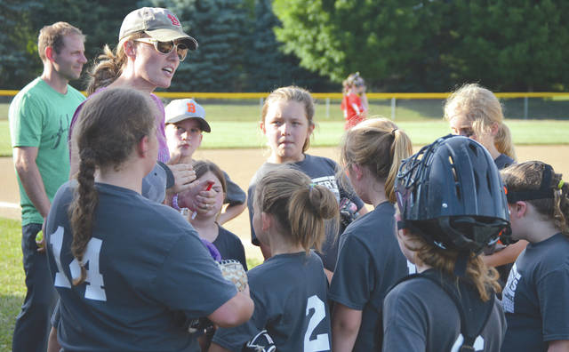 Beavercreek 10U girls softball coach Stacy Dunn talks to her team between innings of a Dayton South Softball League game June 14 at Coy Middle School,