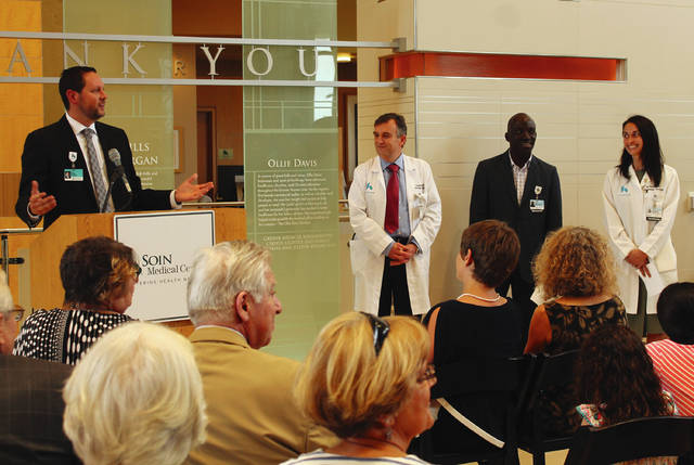Anna Bolton | Greene County News Rick Dodds, president of Soin Medical Center, introduces cancer care physicians to a crowd during the dedication of Soin's new radiation therapy center May 3.