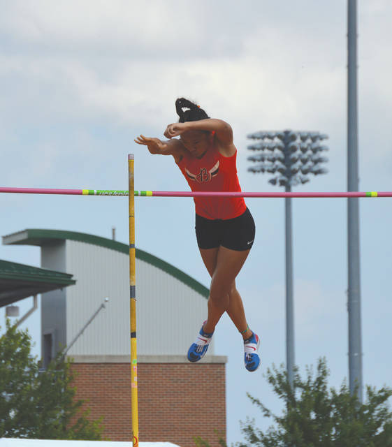 Beavercreek sophomore Eileen Yang pushes the pole away as she clears 12 feet, 4 inches to finish third in the Division I girls pole vault competition, June 2 at the state track and field championships in Columbus.