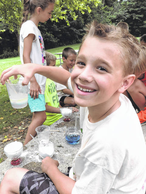 Submitted photo Young campers recently explored the world of Minecraft using natural resources at Greene County Parks & Trails' (GCP&T) Minecraft Camp at the Narrows Reserve. Pictured, participants create edible and non-edible potions to use in their adventures.