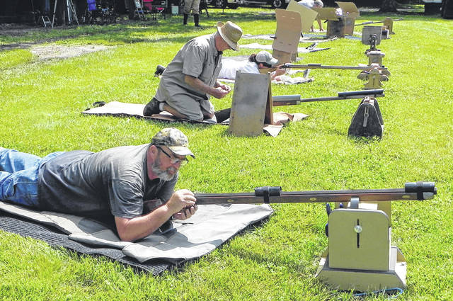 Photos by Larry S. Moore | Greene County News Blue Jacket Muzzleloader club members (front to back) Will Elliott, Roger Stratton an Dawn Swigart on the firing line preparing to fire.