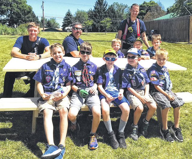 Eight boys from Cub Scouts Pack 74 built a new picnic table for the firefighters of Beavercreek Station 61. They are pictured with some of the firefighters.