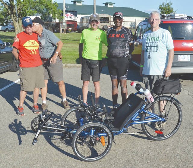 Always ready for hi jinx and fun, members of the Detroit-based Slow Spokes cycling club pose for a group photo prior to Thursday's first day of the Greene Trails Cycling Classic, at base camp on the county fair grounds in Xenia. Left to right: Bill Zakowsky; Ray Carpenter; John Wood; Fred Joyner; and Steve Skinner.