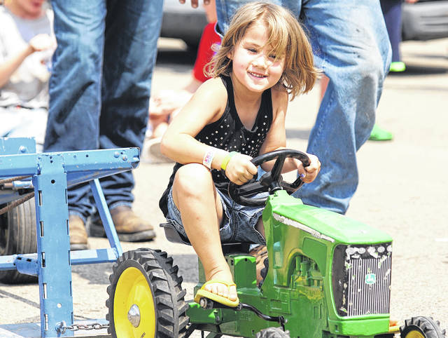 Barb Slone | Greene County News Addison Chambliss was giving it her all in the Kiddie Tractor Pull Aug. 4.