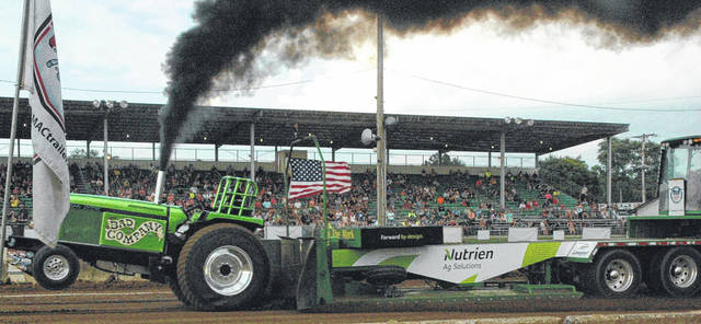 Scott Halasz | Greene County News Greg Kenreigh and his light limited pro stock Bad Company rumble down the clay during the Ohio State Tractor Pullers Association event at the Greene County Fair Aug. 3. Kenreigh recorded a pull of 318.875 feet.