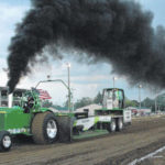Red Rider tops loaded tractor pull field