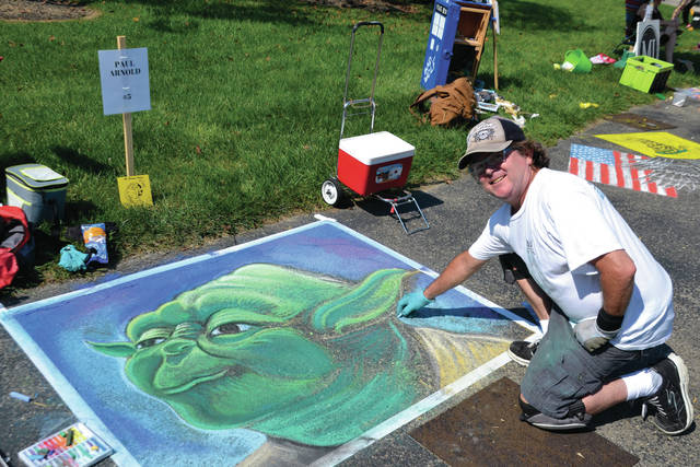File photo Chalk artists displayed their artwork on the sidewalk during last year during ArtFest at Community Park.