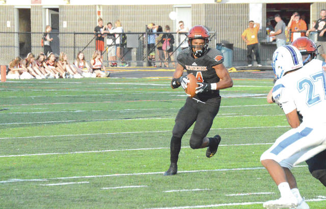 In a losing effort, Beavercreek's Chris Lawrence had gained 94 yards rushing on nine carries, Aug. 24 in a 41-14 loss to Xenia in the annual Backyard Battle high school football game.