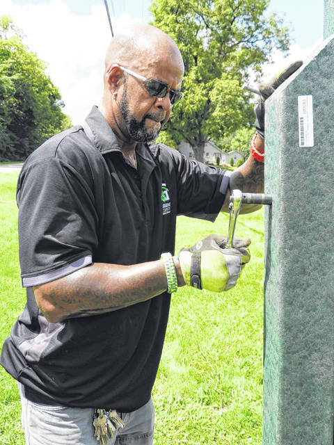 Installing a support post, GCP&T Maintenance Supervisor Dave Dudgeon spent an afternoon this week installing new signs at the Beavercreek parks now owned by the park agency.